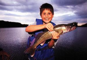 Boy happy he caught fish