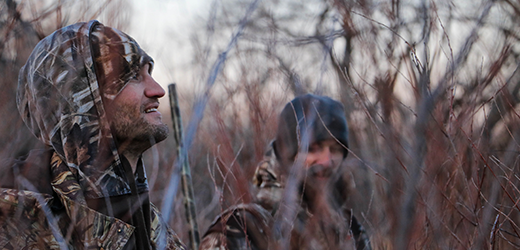 hunters in the woods in winter