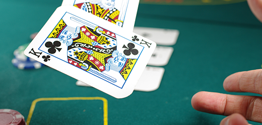 blackjack player tosses cards on the table