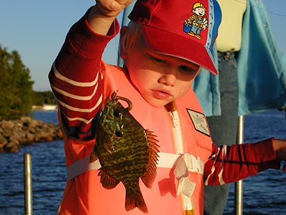 Girl holding fish