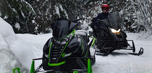 snowmobilers on trail