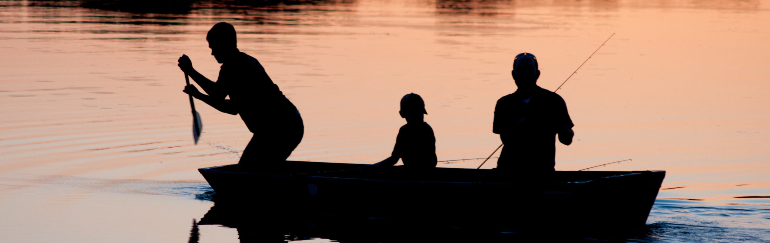 Family Fishing at dawn or dusk