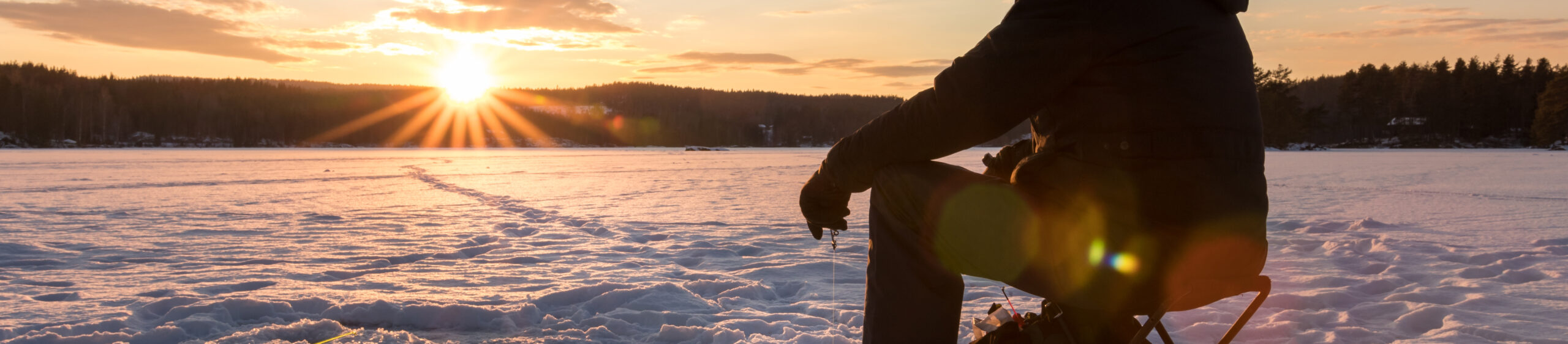 Ice Fishing On Lake